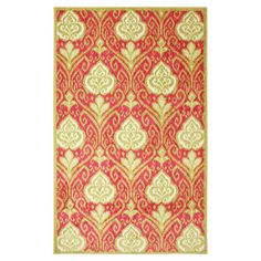 Anchor your dining set or living room seating group in chic style with this elegant rug, showcasing an ikat-inspired damask motif in hot pink.