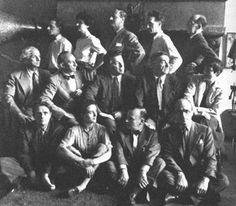 Surrealist in New York - Left to right front: Stanley William Hayter, Leonora Carrington, Frederick Kiesler, Kurt Seligmann  Middle: Max Ernst, Amedee Ozenfant, Andre Breton, Fernand Leger, Berenice Abbott  Back: Jimmy Ernst, Peggy Guggenheim, John Ferren, Marcel Duchamp, Piet Mondrian  (Photographer unknown (MB))