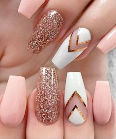 Stunning peachy pink nails with sparkly and white design accent nails using striping tape!
