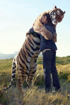 Man  Tiger Hug. Either this is great Photoshop or this dude is the luckiest man in the world!