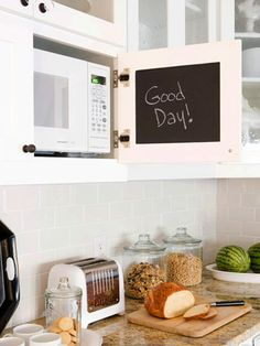 More Manageable Microwave              Here, a microwave stored inside of a cabinet is still convenient and easier on your back than an undercounter placement. Blackboard paint on the inside of the door makes it easy to leave messages and reminders
