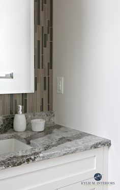 Cambria Galloway with Sherwin Williams Aesthetic White in small bathroom with mosaic tile. Kylie M Interiors
