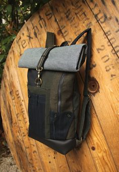 Olive green & blue upcycled rolltop canvas backpack using men's striped trousers in order to create a pocket, by 'eating the goober' Mens Striped Trousers, Blue Canvas, Canvas Backpack, Back Strap, Blue Stripes, Vegan Leather, Olive Green, Upcycle, Backpacks