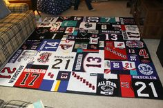 hockey quilt patterns | Close up of the center of the quilt. The black jersey with the green ...