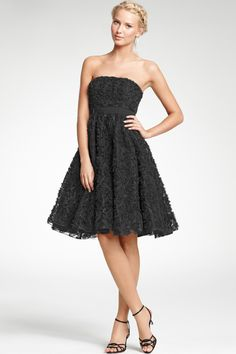 Ann Taylor. Silk Strapless Crinkle Skirt Dress. An ultra-flattering strapless dress featuring a full crinkle skirt for a play of textures and proportions. Grosgrain ribbon at waist accents the feminine silhouette. Hidden side zipper with hook-and-eye closure. Shelf bra with boning at bust. Fully lined.