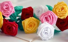 Mini Roses: Mini Roses made from dollar store crepe paper streamers, complete with a really cute video.