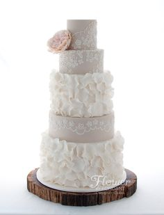 Rustic Lace & Ruffle wedding cake. Beaded lacework matching details on the brides dress. Handmade sugar David Austin Rose to set it all off.