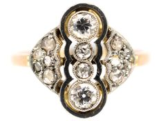 A great design, made circa 1920. This ring is detailed and well executed. It is set with a mixture of old mine cut diamonds and rose cut diamonds on the sides. It is in lovely condition and would make an unusual engagement ring.