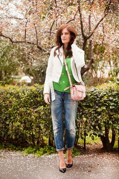 Shop this look for $184:  http://lookastic.com/women/looks/jacket-and-crew-neck-sweater-and-crossbody-bag-and-boyfriend-jeans-and-heels/1600  — White Leather Jacket  — Green Print Crew-neck Sweater  — Pink Leather Crossbody Bag  — Blue Boyfriend Jeans  — Black Leather Pumps