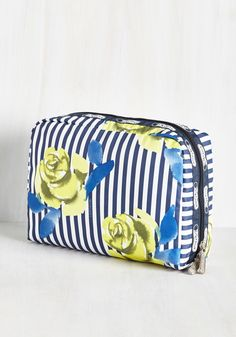 The Rose Best Traveled Makeup Bag. Two roads diverge, and while you wish you could carry every stylish bag you own along with you, this LeSportsac cosmetic case is the wise choice. #multi #modcloth