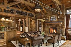 Stunning rustic great room! Especially love the fireplace. #rustichomes www.HomeChannelTV.com