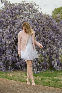White dress, pink leather jacket & pretty purple wisteria