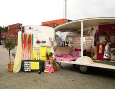caravan revamped by H Home.  i checked the website : cushions & tablerunners with cherries and flowers etc. wow...