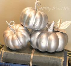 silver pumpkins and old books...pretty