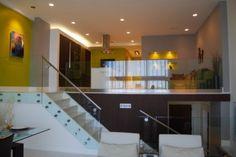 Glass railings for a very sleek modern split level.