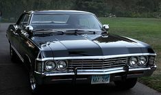 1967 black Chevrolet Impala. Four-door & hardtop. It's seriously my dream car and if I had the funds to take care of one/restore it, I'd by the white one at this crappy used car place down the street.