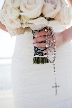 Holding onto a Rosary with her Bouquet