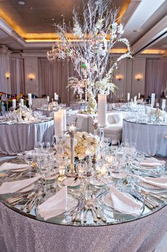 Elevate your all white decor by playing with centerpiece heights!