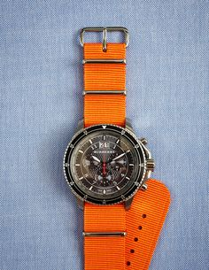 burberry. Casual, colorful and sporty watch for him! Love it!