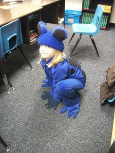 Dart frog costume - the base is just a royal blue jogging suit and stocking cap. I cut circles out of the blue fabric, gathering the edges to make a pouch and stuffing with poly fil. I sewed on black circles for eyes and sewed them onto the hat. The spots are black fabric and the shoe covers are blue fabric. I stuffed the shoe covers so they wouldn't trip her as she walked. Frog Costume, Animal Costumes, Staying Alive, Stuffing, Blue Fabric, Jogging, Circles, Royal Blue, Halloween Costumes