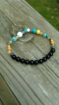Black and multicolored bead stretch bracelet by TyeriDesigns
