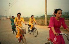 Dai girls on bicycles, outside of Mengla, Xishuangbanna Region, Yunnan, China | Flickr - Photo Sharing!