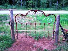 Use an old metal headboard for an upcycled gate