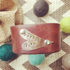 I love this custom brown leather cuff for Natalie! 'Pursue love' on antique bronze heart blank with silver rivets. ❤️ Customize your own cuff!