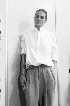 Laura: like a boy Wide and loose linen pants with buttoned up white shirt.