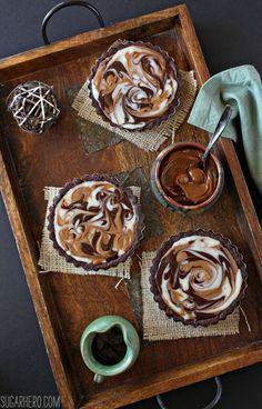 Dulce de Leche Swirled Tarts - dulce de leche + chocolate is AMAZING! | From SugarHero.com