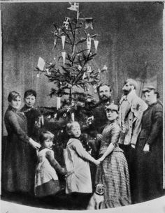 Victorian Christmas tree with flags and paper cones for candies or nuts on it, ca. late 1840s