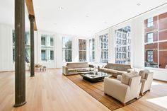 Airy Soho loft featured in 'Big' sells for $9.75M - Curbed NY Soho Loft, Marble Island, White Oak Floors, Radiant Heat, Window View, Main Entrance, White Kitchen Cabinets, Wide Plank, Exposed Brick