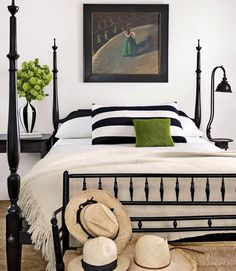 Black and white bedroom with pops of lime green. Love the bench!