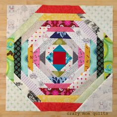 """crazy mom quilts: How to make a Pineapple Block (without paper piecing!) by amandajean I varied the strips in the block from 1.25"""" wide to 1.75"""" wide. These blocks can be made any size...I started with 14"""" blocks ..but bumped up the size to 16"""" after I made a few. This seems to be an ideal size for this strip width and 20 blocks will make a perfectly sized lap quilt.   Keep an eye on your values (lights and darks), so the pattern emerges and is consistent throughout."""