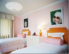 Love the large prints over the matching headboards . . . simple solid colors throughout with just a touch of pattern