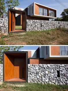 The stone and concrete fence is broken up by a wooden door that provides access to the field behind the house. Concrete Fence, Concrete Houses, Stone Fence, Bamboo Fence, Backyard Fences, Fenced In Yard, Fence Landscaping, Fence Design, Wall Design