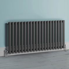 Modern take on Victorian radiator iBathUK | 600 x 1200 mm Horizontal Column Radiator Anthracite Oval Single Panel