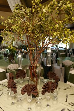 Pretty way to create an outdoor/forest theme for a wedding reception