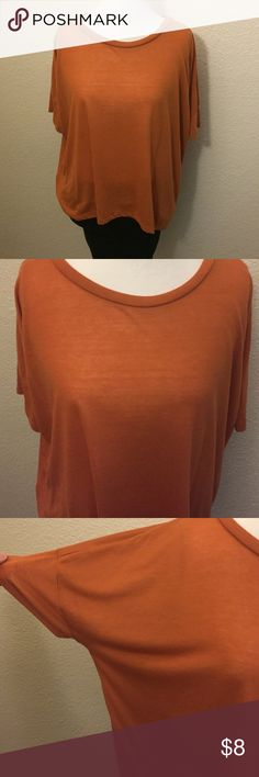 Orange top In good used condition. Worn only a few times. Oversized fit. Old Navy Tops Tees - Short Sleeve