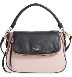 Gleaming hardware adds shine to this compact Kate Spade crossbody bag that's practical as well as beautiful.