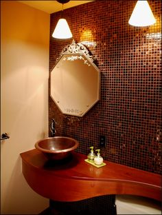 I would love to design a bathroom like this--Could easily be done in shades of green and gold or dark blue and silver, but I'm rather enjoying these shades of rust and copper, etc.