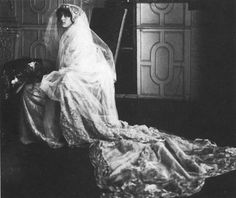 Author, Vita Sackville-West on her wedding day, 1 Oct. to diplomat Harold Nicolson. Her fine cloth-of-gold wedding dress dress was designed by Lady Sackville, the bride's mother.