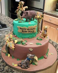 Boar Hunting Birthday Cake MMF with modeling choc hog and dogs with fondant accents.