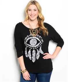 This casual top features an eye and feather dream-catcher graphic. It has long sleeves and a scoop neckline.