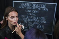 A model has make up applied backstage before showing the BCBG Max Azria collection during New York Fashion Week September 4, 2014. REUTERS/Lucas Jackson