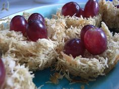 I found this idea here when I was looking for bird activities to do with Bear.  We just finished making them.Yum!As we made them, we talked about the cereal being the twigs and branches, the coconu...