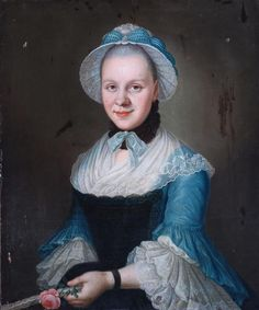 Portrait of a Lady in Blue and Black by Johann Georg Reus, 1769 Germany, the Bowes Museum    The sitter isn't very pretty, but the dress is interesting.  I like the idea of a black stomacher trimmed in lace on a blue bodice and the sleeves