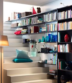 Use EKBY JÄRPEN / EKBY BJÄRNUM wall shelves to make the most of the space next to the stairs, £38 each