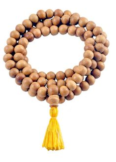 Buddhist Sandalwood Mala - 8mm beads There are 108 beads on this mala. The cord for this mala is made from cotton material, and there is a yellow cotton tassel on the end of the mala. This mala was handmade in Nepal. Sandalwood malas are popular for their lovely fragrance. The healing properties of sandalwood are that sandalwood is relaxing, it is a type of wood that can help you relax, calm down, and see things in a clear light.