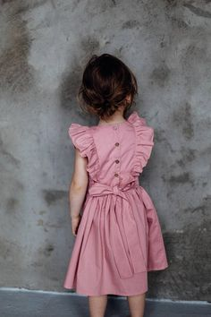 Girls dress with frills and bow, perfect outfit for flower girl or girl birthday. Frills are seasons must have as for baby girls, toddlers and big girls. 100% cotton fabric. Natural coconut buttons. Soft vintage pink color. Lenght: till knee This item is HAND-MADE, MADE TO ORDER item.